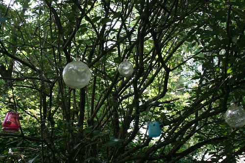 Baubles in tree next to fairy garden