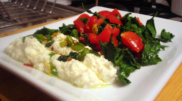 Lamb's quarters and Campari tomato salad, with cow's milk ricotta cheese, garlic scapes and crispy lemon zest