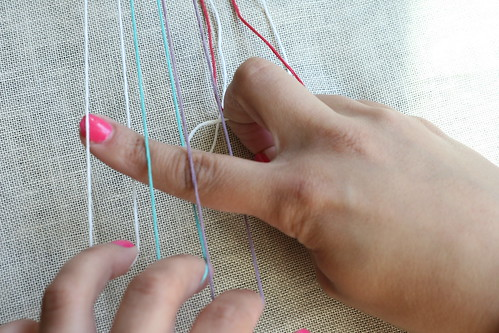 Step 2: Weave finger through strands