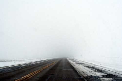 Road in fog and snow on the drive south for the holidays