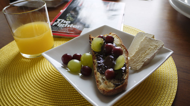 toasted baguette with melted dark chocolate, olive oil and grapes, triple cream cheese and ...mimosa. Good morning, 2011!