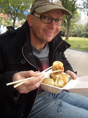 Eating fried dumplings in People's Square