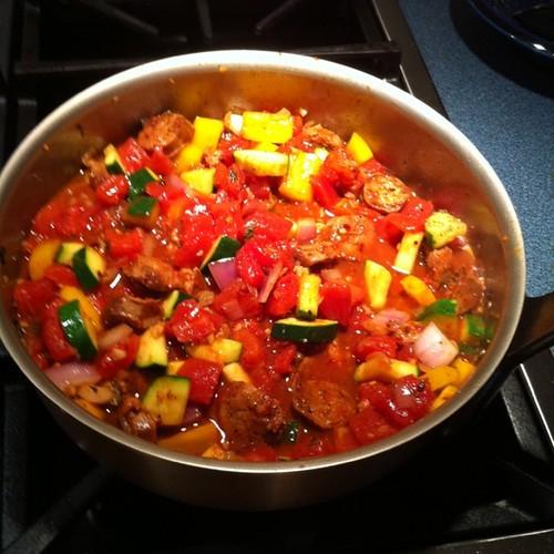 blurry photo of sausage & veggie pasta