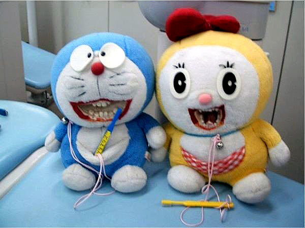 Brush your teeth kids... or these two Doraemon dolls will come bite you!
