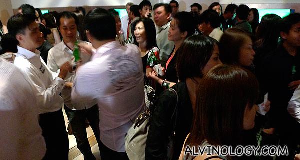 Guests enjoying the free flow of Carlsberg beer