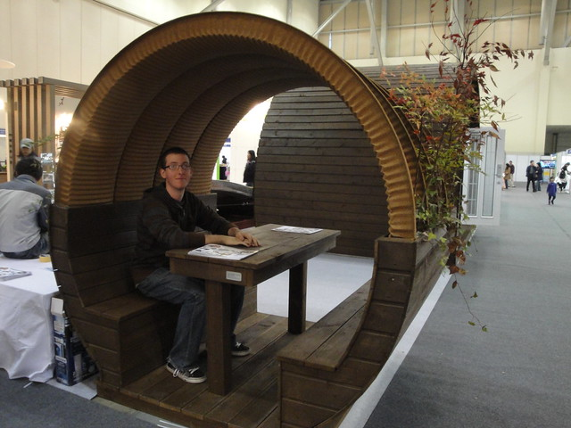 Paul sits at a Fancy Bench