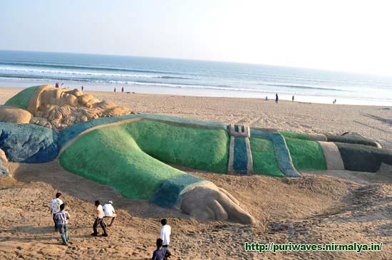 World's longest Green Santa on Golden Beach Puri