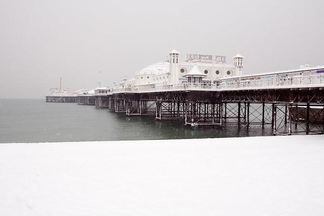 palace (brighton) pier in the snow