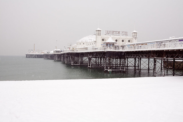 palace (brighton) pier in the snow
