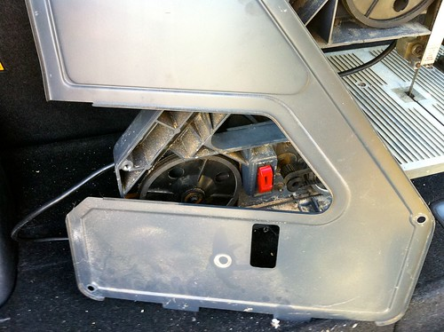 The front panel shows that the drive pulley has been rubbing against the front panel, wearing off the paint and likely helping cause the demise of said pulley.