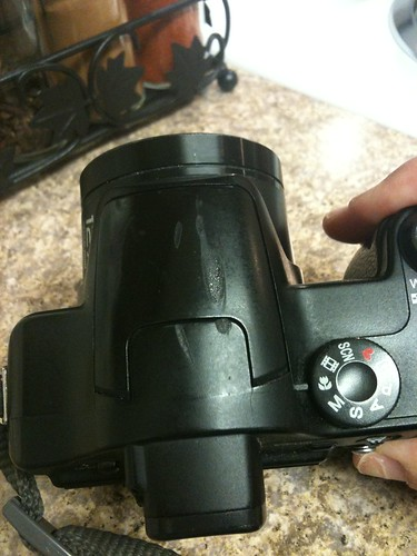 I hurt my camera, fell on hot burner while shooting pictures one night :(