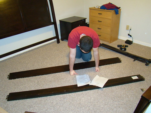 Assembling the bed frame.