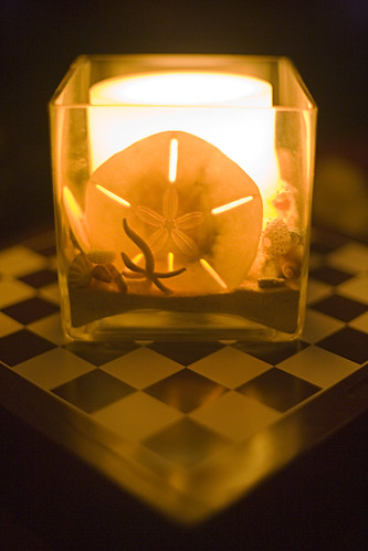 Earth Hour Candle on Checkerboard