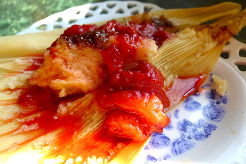 Chocolate tamale with strawberry sauce