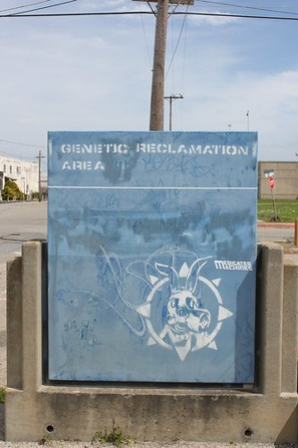 Genetic Reclamation Area: A sign modified to read Genetic Reclamation Area, with a stencil of a rabbit wearing a gas mask.