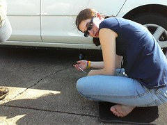 S. learns to change a tire. by ladywriter47