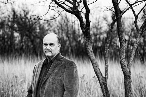 Man standing in prairie
