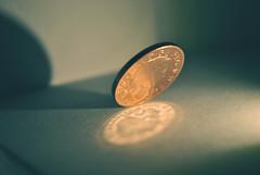 Coin tilt