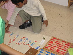 Children working on the phonogram moveable alphabet