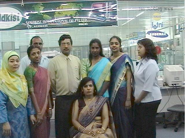 Mr H D Gupta with his Singapore staff, picture from Goldkist International website