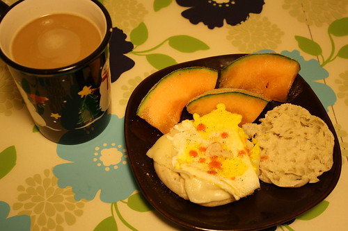 coffee, egg sandwich, cantaloupe