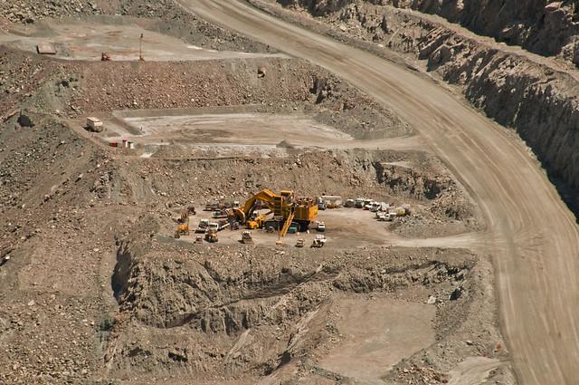 A rather large loader undergoes on site maintenance