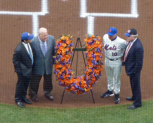 Terry Collins receives a floral wreath from the Shea family
