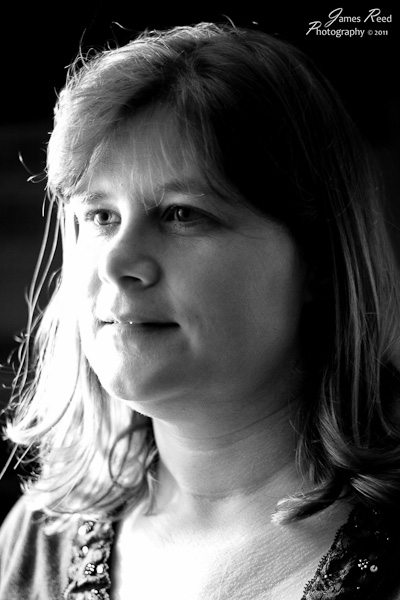 A high key black and white portrait of the wife.