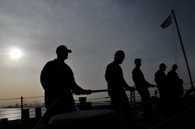 USS Decatur Sailors man a line while in Bahrain.