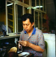 Shoe Maker - Melaka#1 (alemershad) Tags: 120 6x6 tlr film analog mediumformat kodak candid mf analogue manual portra yashica melaka shoemaker twinlensreflex yashicamat124g filem portra160vc vividcolor iso160 jonkerwalk kodakportra alem 35 yashinon80mm vescan alemershad canonscan9000f outingwithphotokedekeriani