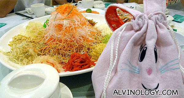 Fa Cai Yu Sheng and a bunny bag of oranges greeted us at our table when we sat down