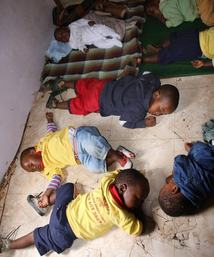 Children sleeping on bare linoleum