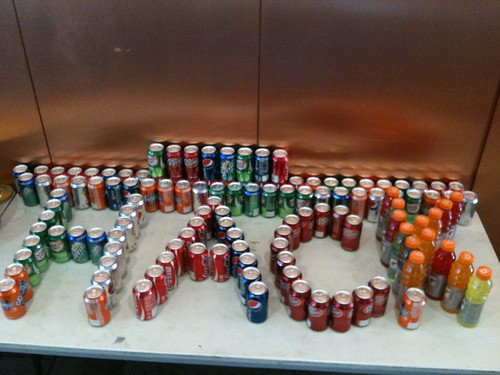 "picture of cans arranged to spell ""Hack"""