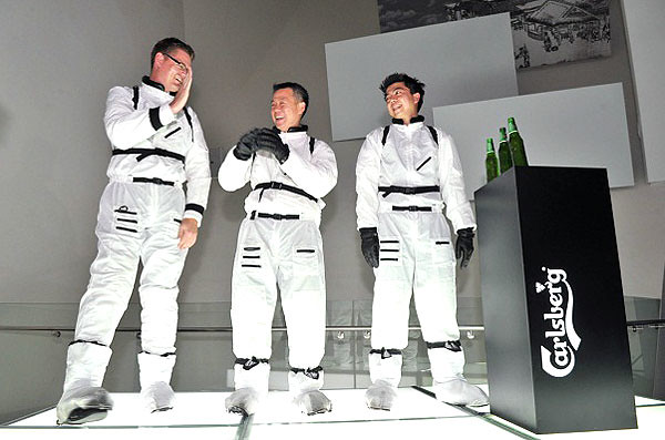 Carlsberg senior management team in astronaut suits at the relaunch event