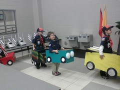 Tiger cubs line up with their box cars.