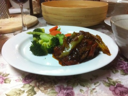 Simmered pork with Gravy and steamed vegetables.