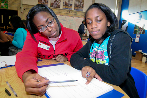 Corps member working with a student