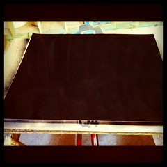 1st coat of chalkboard paint on homemade magnetic chalkboard