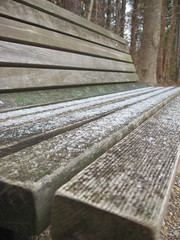 snow scattered on bench