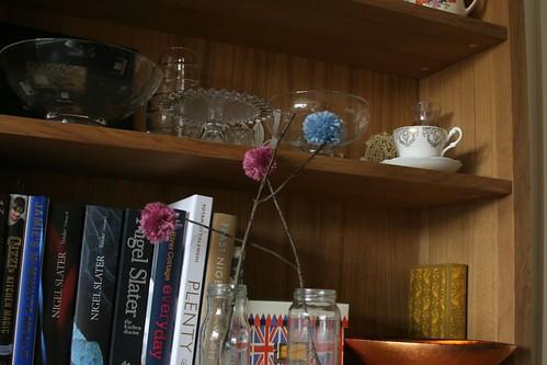 Dresser with pompom flowers