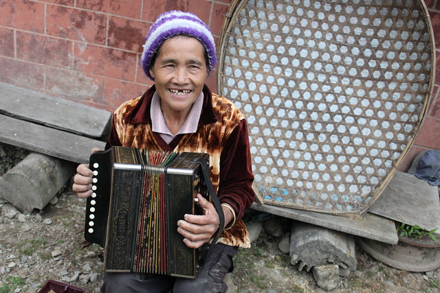 Old Lady playing the accordion in Benguet - 1