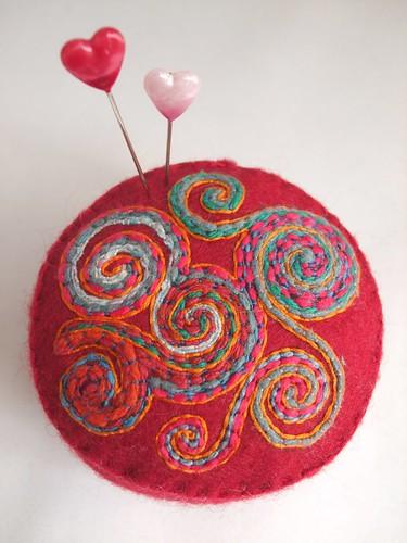 Celtic Spirals pincushion in red