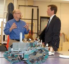 Article image: Commissioner Bowen speaks with a Sanford Regional Technical Center instructor David Dorr.