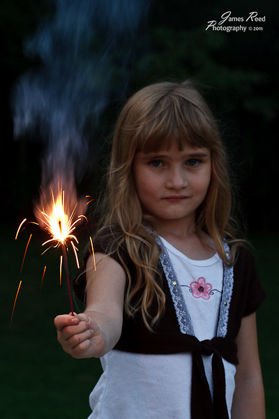 The little one takes her duties as official torch bearer seriously.
