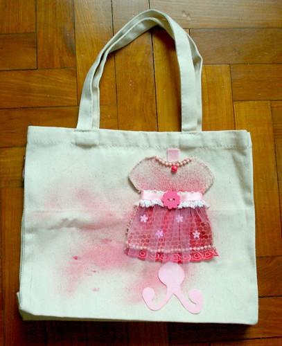 Dress form on canvas bag
