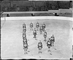 "Bruins form the letter ""B"" on the ice, Boston Garden, 1930-31"