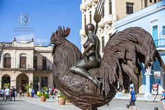 A naked woman on a giant Rooster in Havana.