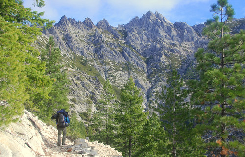 Backpacker along PCT in Castle Crags Wilderness, California