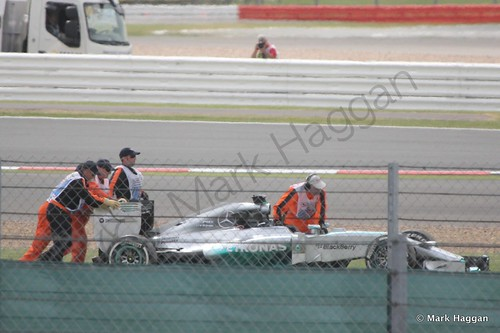 Pushing Lewis Hamilton's stranded car during Free Practice 2 at the 2014 British Grand Prix