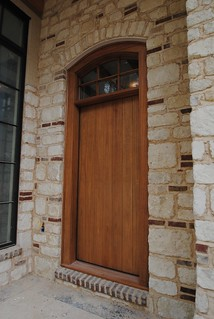 8 ft tall slab door with true divided light window.